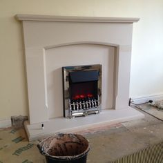 Durastone fireplace with electric fire