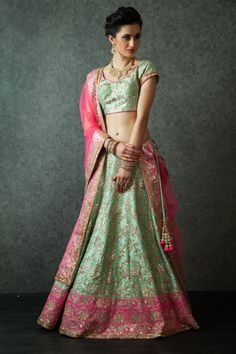 W16-141 - Pure raw silk lehenga and blouse with net dupatta embellished with zari and gota work