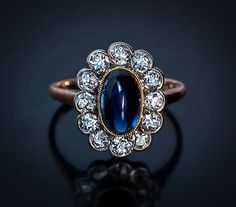 Vintage old cut diamond and cabochon sapphire cluster ring. Russian rings for sale.