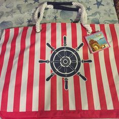 Large Beach Tote This is a beautiful nautical themed beach tote! There's a pouch for wet swimsuit. Inside pocket. Large main compartment. Comfortable shoulder straps! Life is a beach Bags Totes