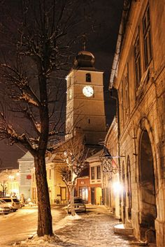 The Clock Tower from the Main Square in Sibiu, Romania-this looks like a Thomas Kinkade painting.