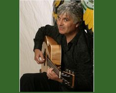 Circa July 2009, fingerstyle guitarist Laurence Juber is pictured in a promotional image with his prized custom Martin guitar Credit: Courtesy of Laurence Juber