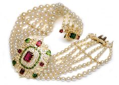 Ganjam's choker from their Nizam Collection, with colored gemstones, diamonds, and pearls, all set in yellow gold.