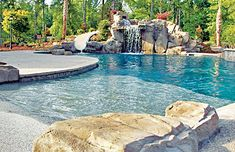 Zero beach entry swimming pool with large rock waterfall grotto and rock water slide