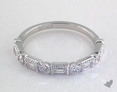 SKU 49920 - Round brilliant diamonds alternate with sleek  baguette shape diamonds to create this vintage inspired charmer. Wear this versatile ring stacked with an engagement ring, stacked with other bands or alone; the choices are endless.