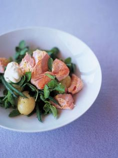 Chunks of lemony fish scattered over a light salad of watercress, herbs, green beans and potatoes – all topped off with a dollop of garlicky yoghurt.