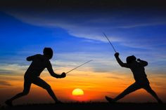 Silhouette fencers with sunset | Flickr: Intercambio de fotos