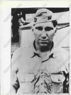"""LIBERATED: Maj A. K. Wermuth of Chicago, who became known as a """"one-man army"""" during the battle of Bataan when he accounted for more than 300 Japanese, Is shown as he arrived at the 29th Repatriation Depot near Manila after being liberated from Japanese prison camp at Mukden, Manchuria. 1945."""