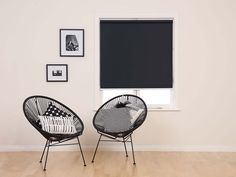 Get total light block without the bulk with Harvey's Ebony Readymade Blockout Roller Blinds