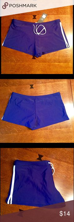 Cute Mossimo women's swim shorts.  Cute women's swim bottoms in navy blue.  Swim shorts have a brief insert.  Navy blue with white stripe.  82% nylon and 18% spandex.  Brief is 100% polyester.  2 1/2inch inseam, approx. 35 inch waist.  New with tags, never been worn. Mossimo Supply Co Swim