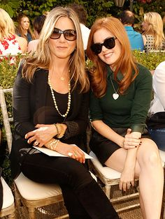 Still basking in the glow of her recent engagement, Jennifer Aniston buddies up to Isla Fisher during an Audi-sponsored CFDA/Vogue Fashion Fund event Thursday afternoon at L.A.'s Chateau Marmont.
