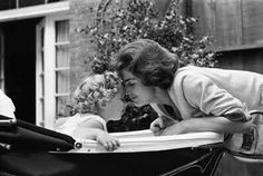 Jackie Kennedy sharing a loving moment with little Caroline on Mother's Day.