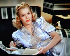 Screenshot I took from Moon Over Miami of Carole Landis relaxing in a gorgeous blue silk and cream lace boudoir robe.