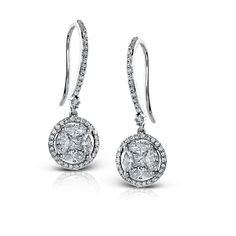 These dazzling 14k white gold earring from our Delicate Diva Collection focus on a .18ctw princess cut diamond in each earring, with .60ctw marquise cut diamonds, and are surrounded by .33ctw of round white diamonds in the halo of the stunners.