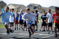 Meridian Ranch Elementary School fourth grader Brayden Hall, 9, races during a boys 4-by-100-meter relay event May 16 at Sand Creek High School in Falcon School District 49. More than 300 fourth and fifth graders from nine elementary schools gathered for the 11th annual District 49 track meet. During the daylong athletic activities, they competed in eight events: 100- and 200-meter sprints; 800-meter dash; 4-by-100-meter relay; long jump; shot put; softball throw; and Frisbee toss.