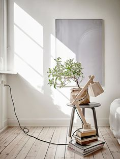 Muuto lamp and books as a bedside table. Duvet day in this beautiful bedroom?!