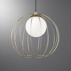 Drawing inspiration from vintage globe birdcages, Mermelada Estudio's modern pendant delicately encloses a single frosted glass globe. Open framework in warm brass finish is a minimalist dream. Glass Globe, Glass Globe Pendant, Vintage Globe, Cage Pendant Light, Light, Pendant Lamp, Lights, Globe Pendant Light, Modern Pendant Light
