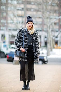 A Clever Way To Wear Your Leggings Out This Winter #refinery29  http://www.refinery29.com/2015/02/82568/leggings-under-skirts#slide-4  You can wear a paper-thin skirt with a big, warm coat and make it look cohesive by layering a pair of leggings underneath. This model chose to forgo them for bare legs, but we actually think this ensemble would look even better (not to mention, feel better) with a pair of thermals on underneath. For a similar style, try: