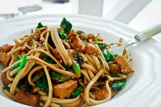 Vegan Udon Noodle Stir Fry-- This stir fry uses tofu as a great protein substitute for a meatless monday meal inspired by my friend and Taste co-mentor Nigella Lawson