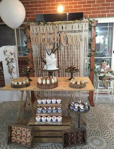 Wild one DIY styling using all our rustic props, trestle table, cake stands and rustic arbour. Loving the macrame backdrop