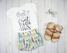 This adorable cactus print summer girl outfit is perfect for your little girl, whether shes brand new or a playful toddler. Choose from the Cant Touch This cactus bodysuit, the bloomer shorts with the matching new style bow, or the whole outfit. The full outfit includes handmade 100% #cactus #summeroutfit #babygirloutfit #babygirlclothes #etsy