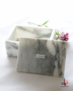 Selected and precious Arabescato marble of Carrara, background white hot with gleaming with grey-green veins running, refined and elegant look.  One of à Kind for a King (or Queens).