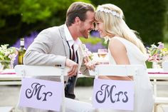 Mr. and Mrs. chairs with the newlyweds enjoying every minute of their day.