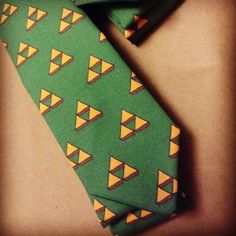 Available at etsy.com/shop/thegeektonian  zelda inspired necktie for geek weddings. We also make custom neckties to fit your wedding theme.