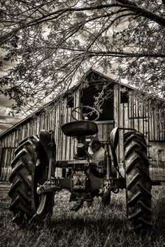 Old Tractor and Barn probably used years ago together as working partners, now the sit and watch the days go by...