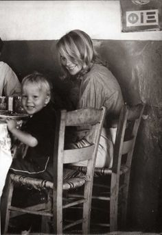 Marianne Ihlen with her son Axel Joachim at Grafos taverna in Hydra in 1962. From So Long, Marianne: A Love Story.