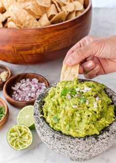 Copy Cat Chipotle Guacamole! If you love the lime- and cilantro-spiked guacamole from Chipotle Mexican Grill, then this recipe is for you. It will make all of your tortilla chip dipping dreams come true. #guacamole #gamedayfood #cincodemayo #chipotle #simplyrecipes