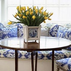 Fresh! Blue, white and yellow banquette.