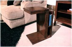 """Chair Side End Table by Ashley Furniture by Ashley. $92.72. Aged bronze color hardware. Made with select veneers and hardwood solids in a warm brown finish. Framed drawer and door fronts. Unique nesting end table has magazine shelf.. Made with select veneers and hardwood solids """"Famous Collection""""n a Warm Brown Finish. Framed drawer and door fronts. Aged Bronze color hardware. Unique nesting end table has magazine shelf. Dimensions:Inches: 12 W x 16 D x 22 H25..."""