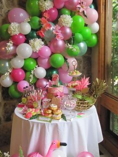 Such an awesome Pink Flamingo birthday party! It has a tropical feel to it. The balloon backdrop is amazing! See more party ideas at CtachMyParty.com