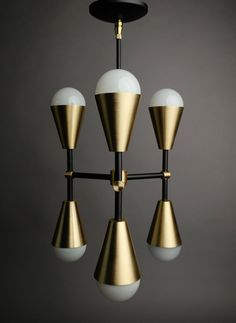 Matte Black and Brass 6 light chandelier. Great for small dining room tables or large bar pendants in a restaurant environment. Includes 60w equivalent 120v LED bulbs. Other finishes and colors available. Message for more info. E26 medium base sockets G25 LED bulbs included Dia 12.0 Height 23.0 Message for custom drop height. (Top of ceiling to bottom of fixture) UL listed in North America Visit us at www.southernlightselectric.com for more info, news, tips on proper lighting and our g...