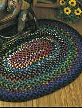 """Aggie's Braided Rug Technique - Crochet  Braided strips crocheted from scraps of worsted weight yarn create this warm and inviting 38"""" x 48"""" oval rug.  Skill Level: Easy  $2.99"""