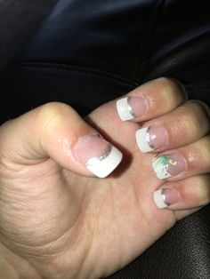 White and silver French tip and design on the ring finger