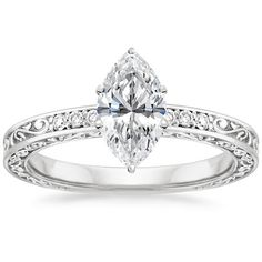 I normally don't change the description on these but this is the prettiest ring I think I've ever seen. Has everything I love marquise cut and an interesting beautiful band 18K White Gold Delicate Antique Scroll Ring from Brilliant Earth