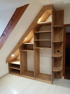 Attic Closet Ideas - Walk-in attic storage room features a sloped ceiling lined with rustic wood beam of lights over angled built in shoe cubbies as well as sweater racks next to a home window seat. House, Hangout Room, Small Spaces, Home, Closet Bedroom, Apartment Living Room, Trendy Apartment, Stairs Design, Attic Shower