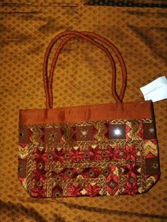$59.00 Handbags  Womens Sari Handbag Choclate Brown Bollywood Purse - Ethnic Indian chic sari handbags with an elegant style are the very latest Bollywood craze.Gorgeous colors with beautiful beads and fabric handles these purses/ handbags are available in a variety of colors and design to match every outfit. http://www.amazon.com/dp/B005FJM5MC/?tag=pin0ce-20