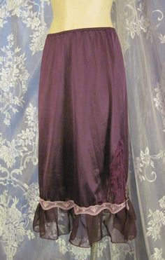 Slip skirt has been hand-dyed a rich eggplant color. Added detail of chiffon and lace has been added around the edge. Small side slit gives this skirt