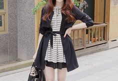 This is a cute combination with the striped dress with the black cardigan tied with the bow.