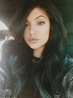 Hitting back: Kylie took to Instagram to take an apparent swipe at those who have accused her of going under the knife, writing: 'Shame on me for changing. Shame on you for staying the same.'