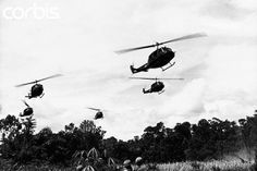 14 Aug 1965, Pleiku, Vietnam --- Bell UH-1D Iroquois helicopters fly support for the 173rd Airborne Brigade on a search and destroy operation at Pleiku during the Vietnam War.