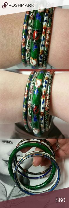 """Vintage lot of Chinese cloisonne bangles Vintage lot of Chinese cloisonne bangles with floral motifs. In the lot there are two white, one black, one blue, and one green. These are form the 30's and were from my great aunt's estate sale.   The smaller of the set are just over 1/8"""" thick each and the larger green one is just over a quarter of an inch thick. Openings for all are just a bit over 2.5"""". Worn together they make a nice jingle :) reasonable offers welcome and accepted Vintage Jewelry…"""