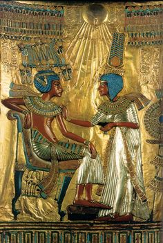 Tutankhamen with His Queen Ankhesenamen. Detail on the back of the throne of King Tutankhamen, from the tomb of Tutenkhamen, Valley of the Kings (c. 1355-1342 BC). Carved wood covered with gold and inlaid with faience, glass paste, semiprecious stones and silver. Egyptian Museum, Cairo.