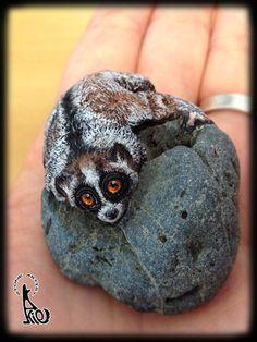 Slow loris painted on stone