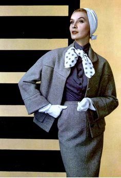 1955 tweed suit worn with silk blouse tied with polka-dot scarf, by Manguin, white jersey turban by Paulette