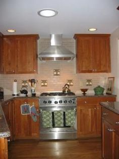 cherry wood shaker style by Oceanside Cabinets