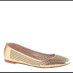 Nora Perforated Ballet Flat Gold ballet flat, with small cut outs from toe until heel. Size 7 but may fit 7.5. J. Crew Shoes Flats & Loafers